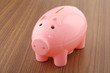 Pink color piggy bank isolated
