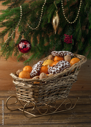 Christmas composition with evergreen and fresh clementines .