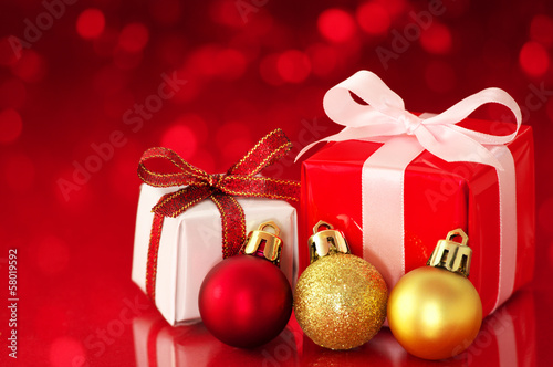 Small presents on red sparkle background.