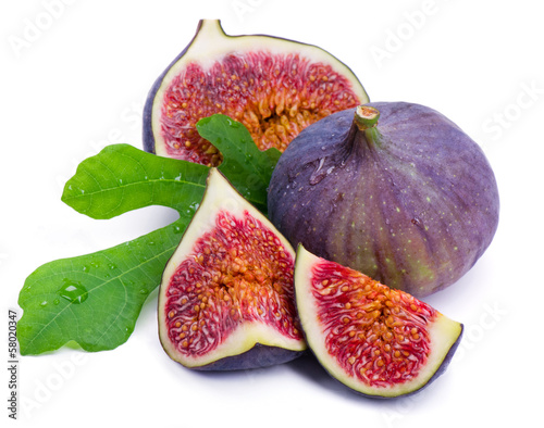 Ripe, beautiful fig,green leaf isolated on white background.