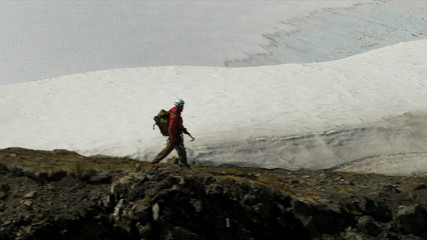 Aerial view of male mountain climber in summer, Alaska, USA