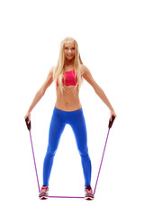 Cute aerobics instructor posing with skipping rope