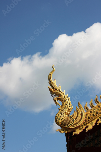 Golden Naga with blue sky