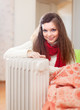 long-haired woman near oil heater