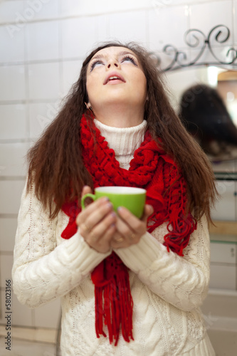 woman gargling throat in her bathroom