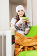 girl relaxing with cup of tea  in winter