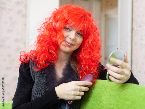 Woman in red wig with comb