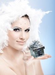 Attractive winter girl with present box