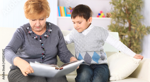 Grandmother and grandson reading a book