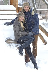 Outdoor photo of happy couple at winter
