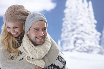 Portrait of loving couple at wintertime