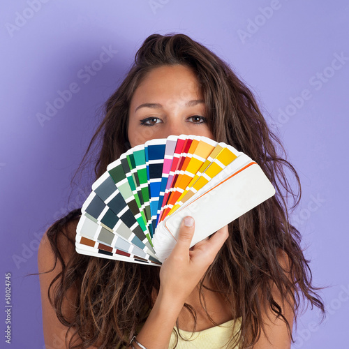 Girl portrait with colors palette against colorful purple backgr