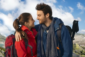 Couple in warm clothes trekking