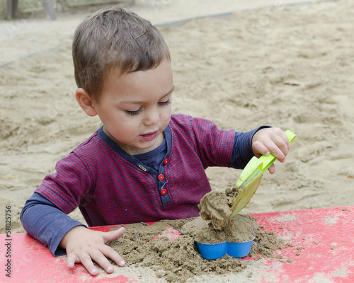 Child playing in sandpit