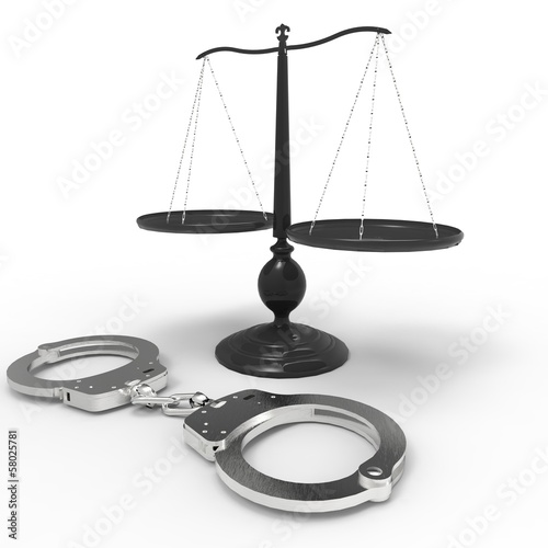 Scales of justice and handcuffs concept - 58025781