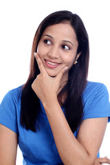 Smiling young woman thinking