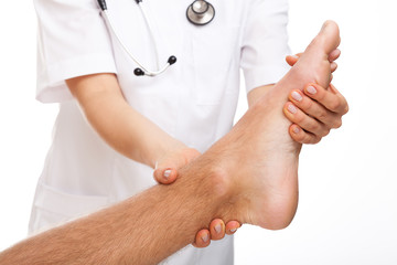 Physician examining painful foot