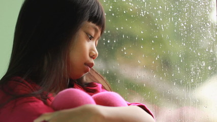 Depressed Asian Girl On Rainy Day