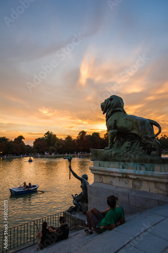 Lion sculpture in Buen Retiro park lake, Madrid