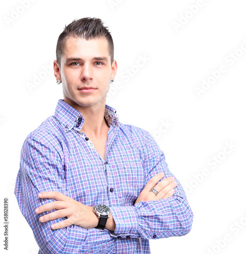 Casual young man looking at camera with arms crossed