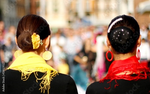 heads of two women with very hairstyle