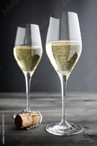 Fotobehang Wijn Two glasses of Champagne and Cork, selective focus