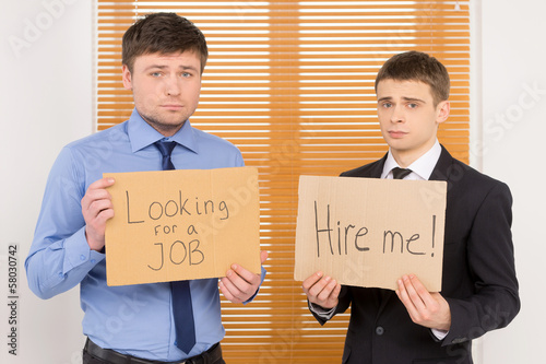 Two unemployed men looking for a job.