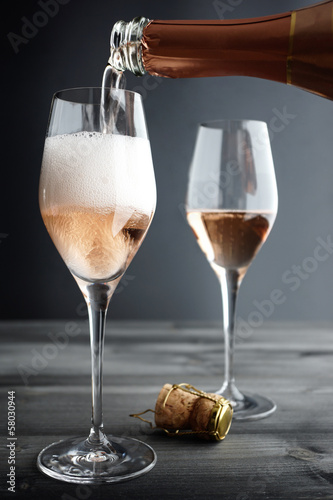 Fotobehang Wijn Rose Champagne being filled into Glass