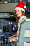 Pilot in the Cockpit with Santa Hat