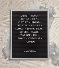 Vacation concept in plastic letters on very old menu board