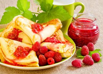 Homemade pancakes with raspberry jam