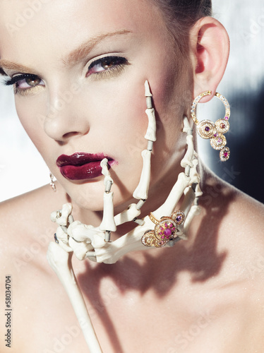 Surrealistic fashion portrait of a woman wearing jewellery