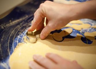 hands making biscuits