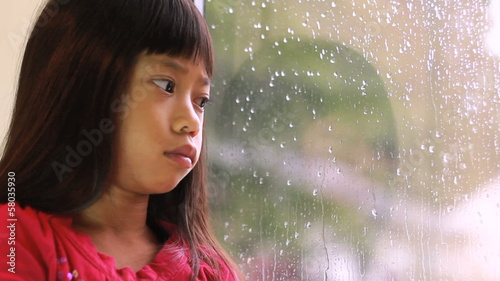 Sad Little Girl On A Rainy Day