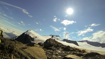 View of lone male climber nr distant helicopter, Alaska, USA