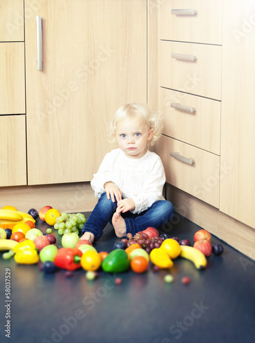 toddler with fruit