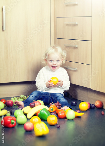 little girl with orange