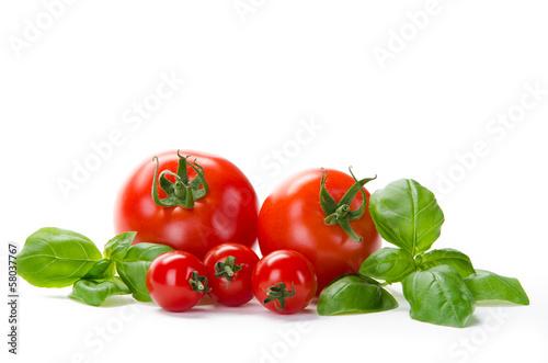 Leinwanddruck Bild 5 Tomaten mit Basilikum