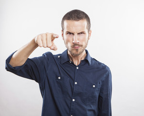 angry young man accusing you, pointing finger at you!