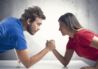Arm wrestling between a couple