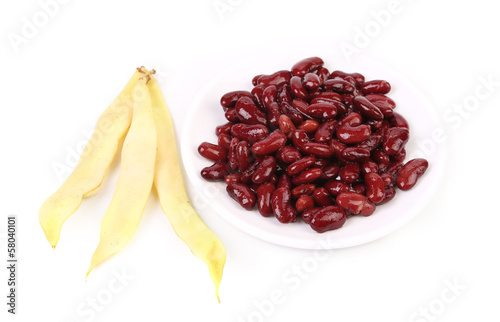 Yellow pods and red beans