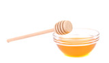 Bee honey with wooden dipper