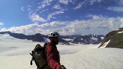 Climber filming selfie to post online, Alaska, USA