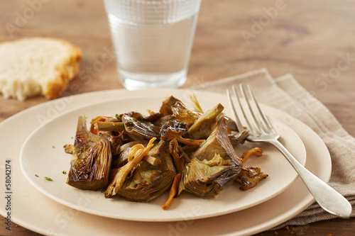 Dish of sauteed artichokes and yellow foot mushrooms