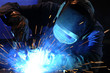 worker while doing a welding with arc welder - 58042709