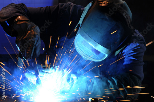 Leinwandbild Motiv worker while doing a welding with arc welder