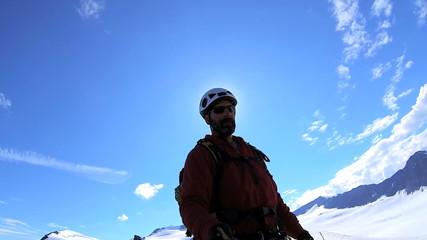 Peak Mountain climber filming selfie trekking  Alaska, USA