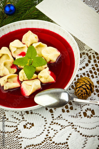 Traditional Christmas borscht with mushrooms filled in dumplings