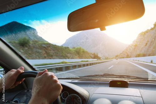 Leinwandbild Motiv driving car on the mountain road