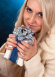 girl holding a white and blue gift